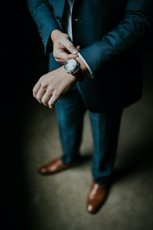 man holding his black suit