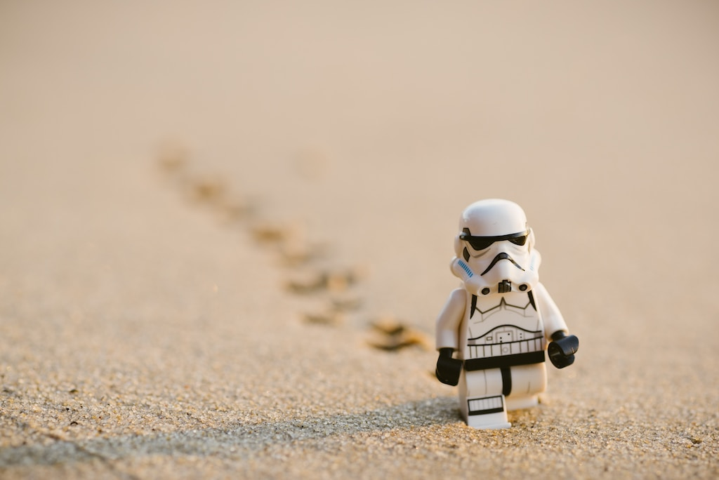 Stormtrooper minifigure walking on the sand