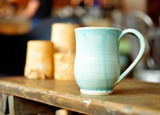 focused photo of a blue ceramic mug