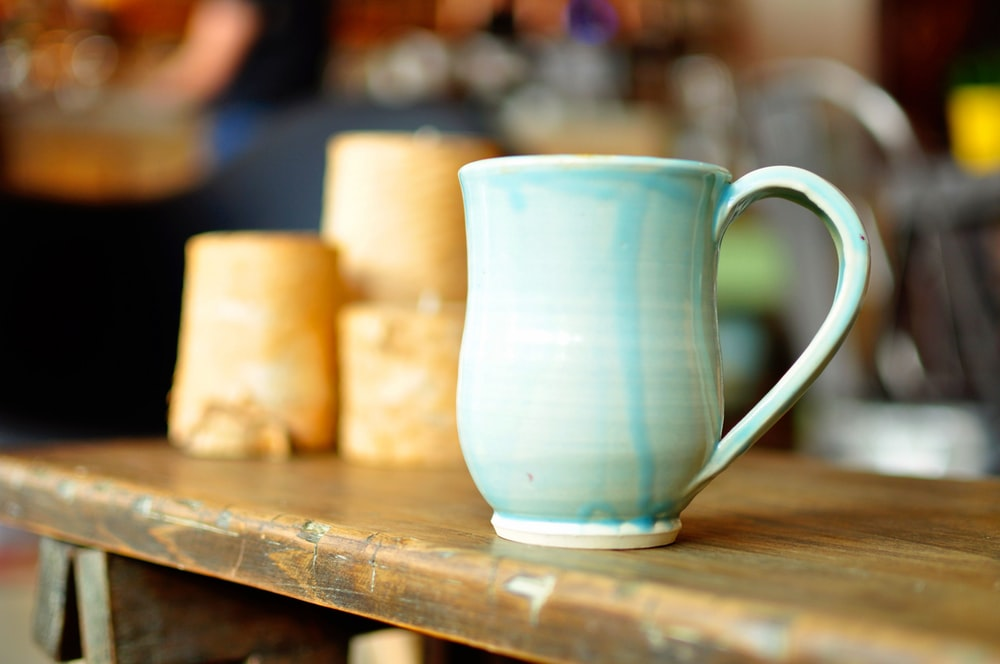 focused photo of a blue ceramic mug