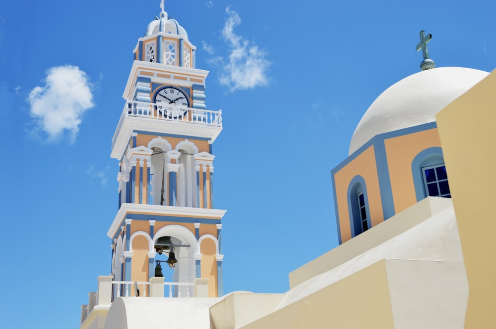 white and yellow concrete tower and dome building
