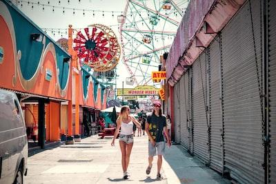 two women walking on amusement park