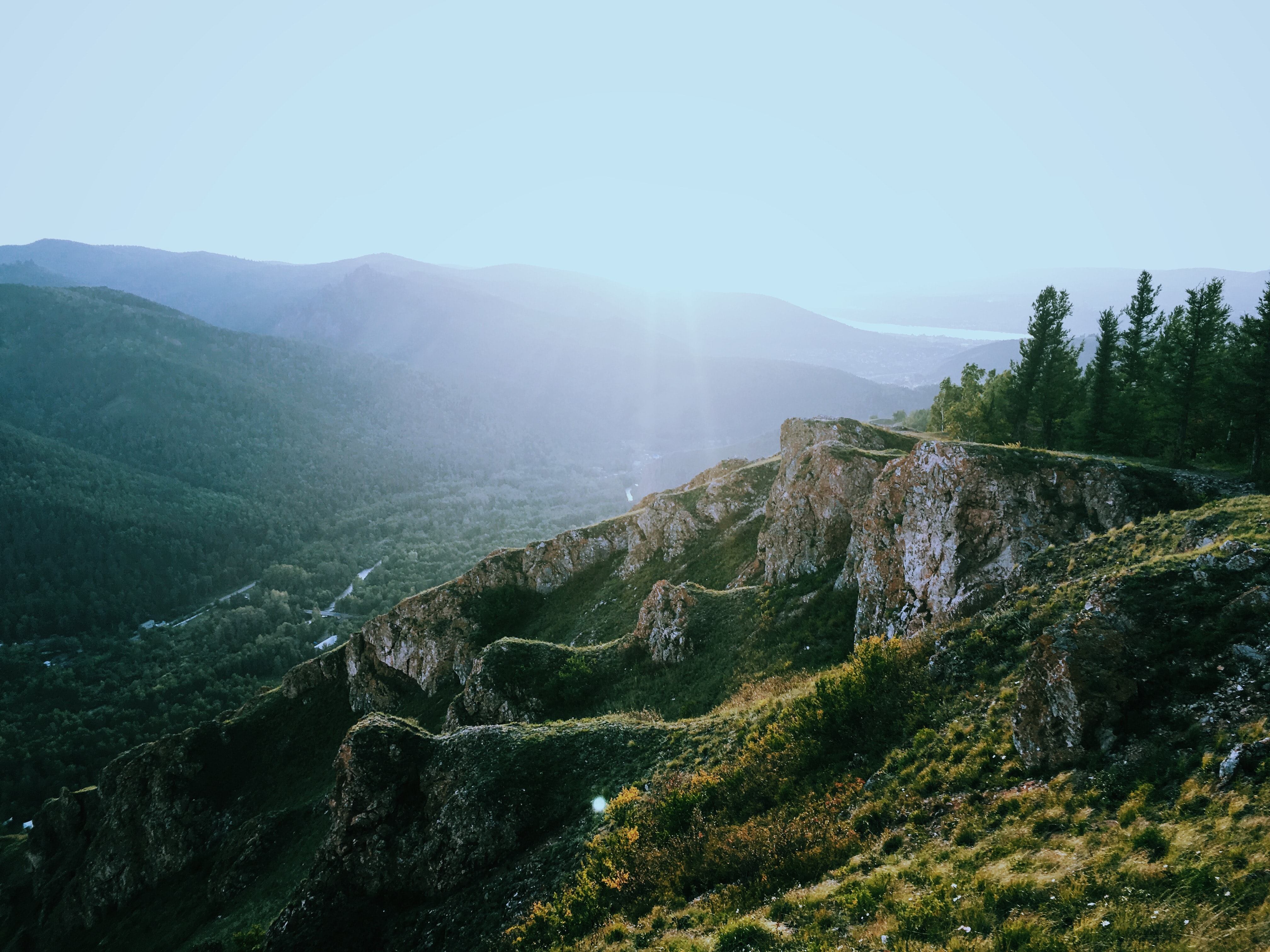 A rocky slope over a green valley in Russia