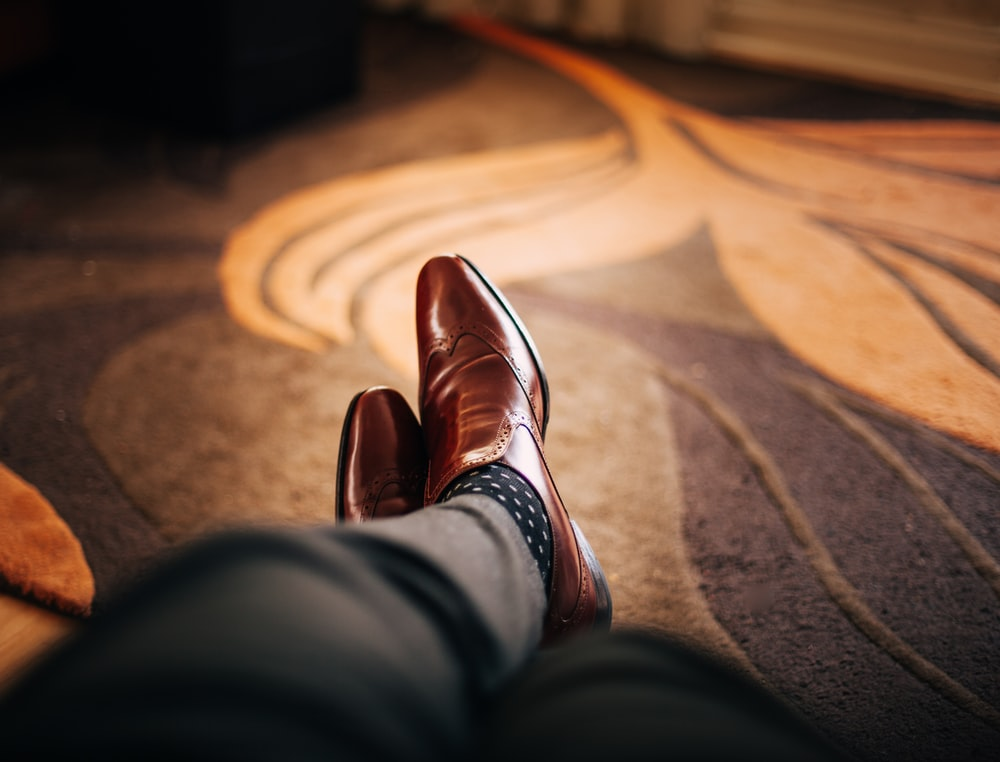 pair of brown leather dress shoes