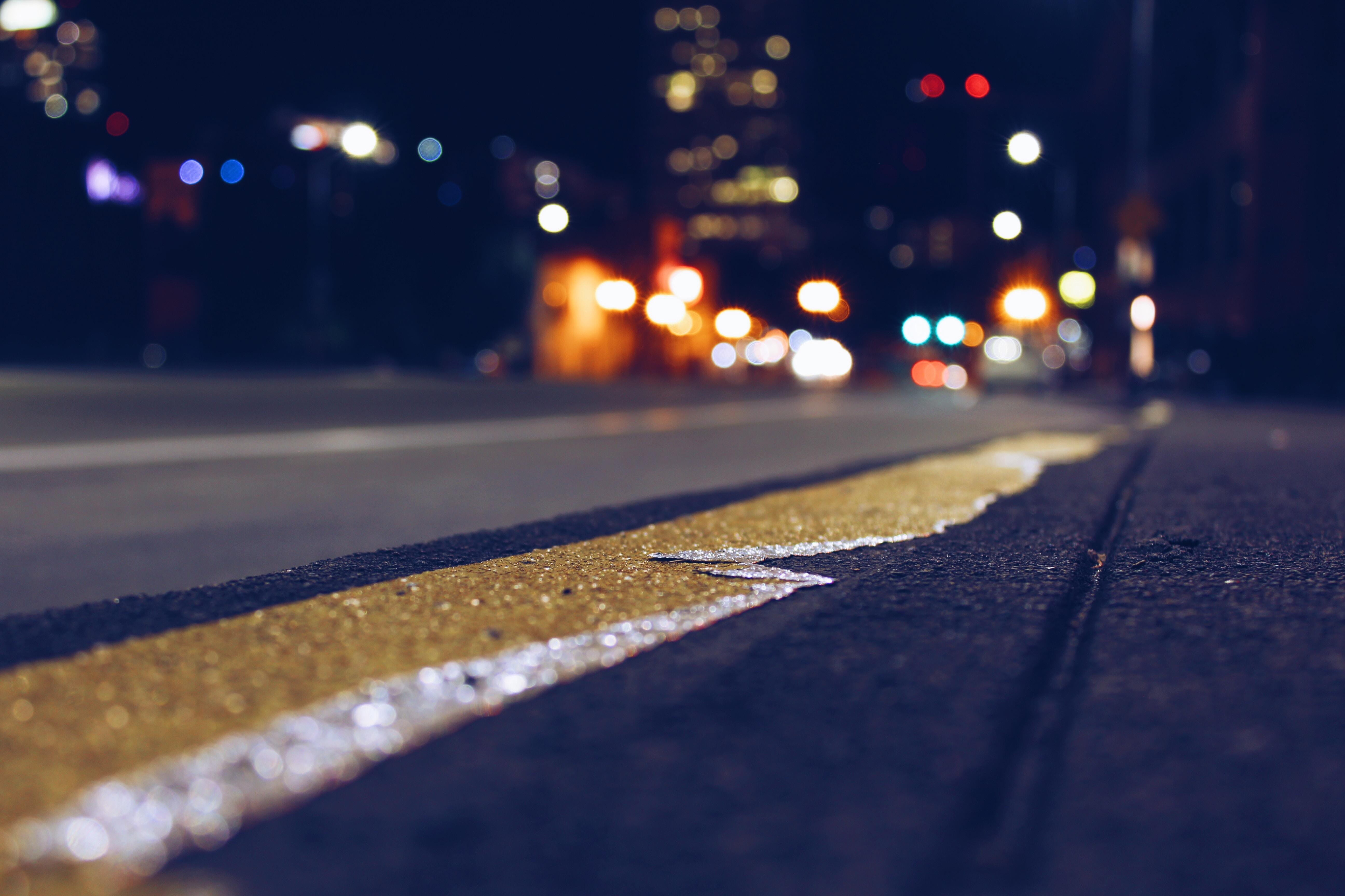 Closeup of a busy urban street at night