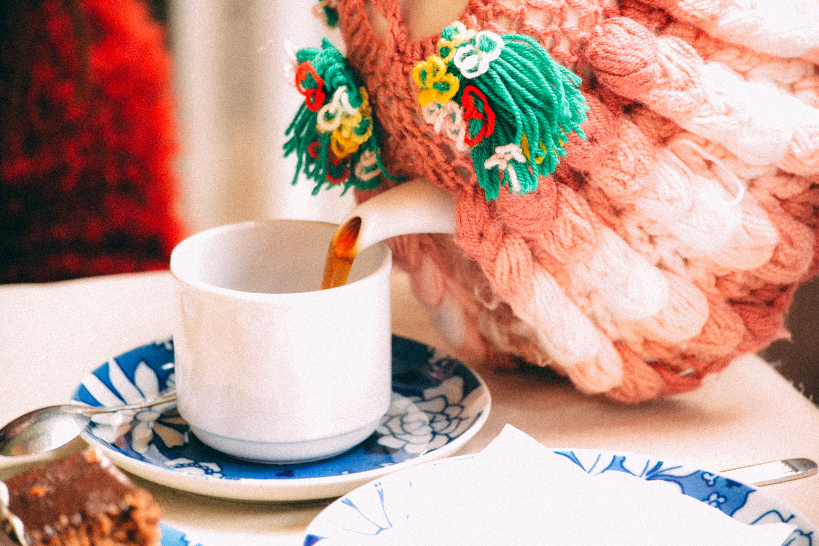 selective focus photography of person pouring teacup