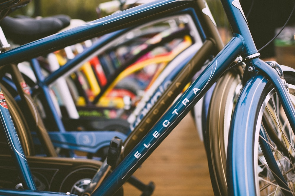 close shot of blue and white Electra bicycle