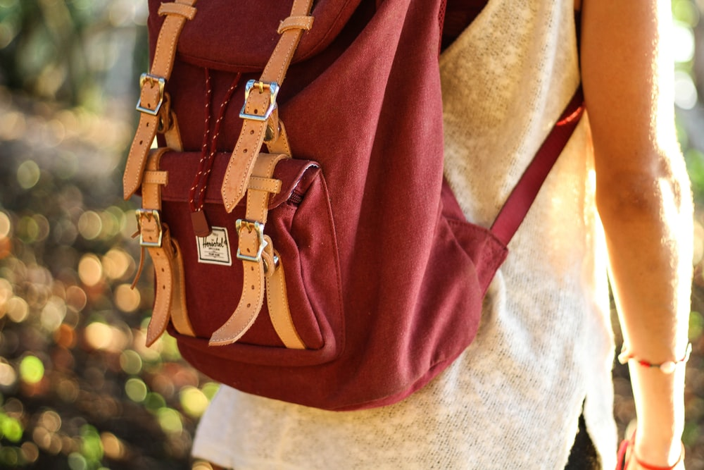 person with red rucksack
