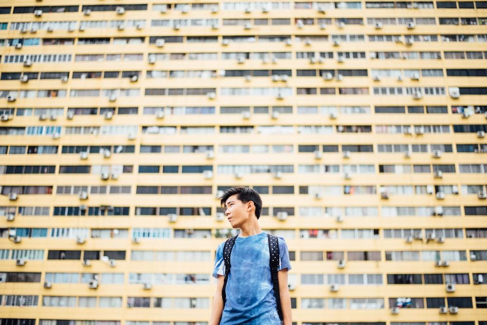man standing in front of skyscraper