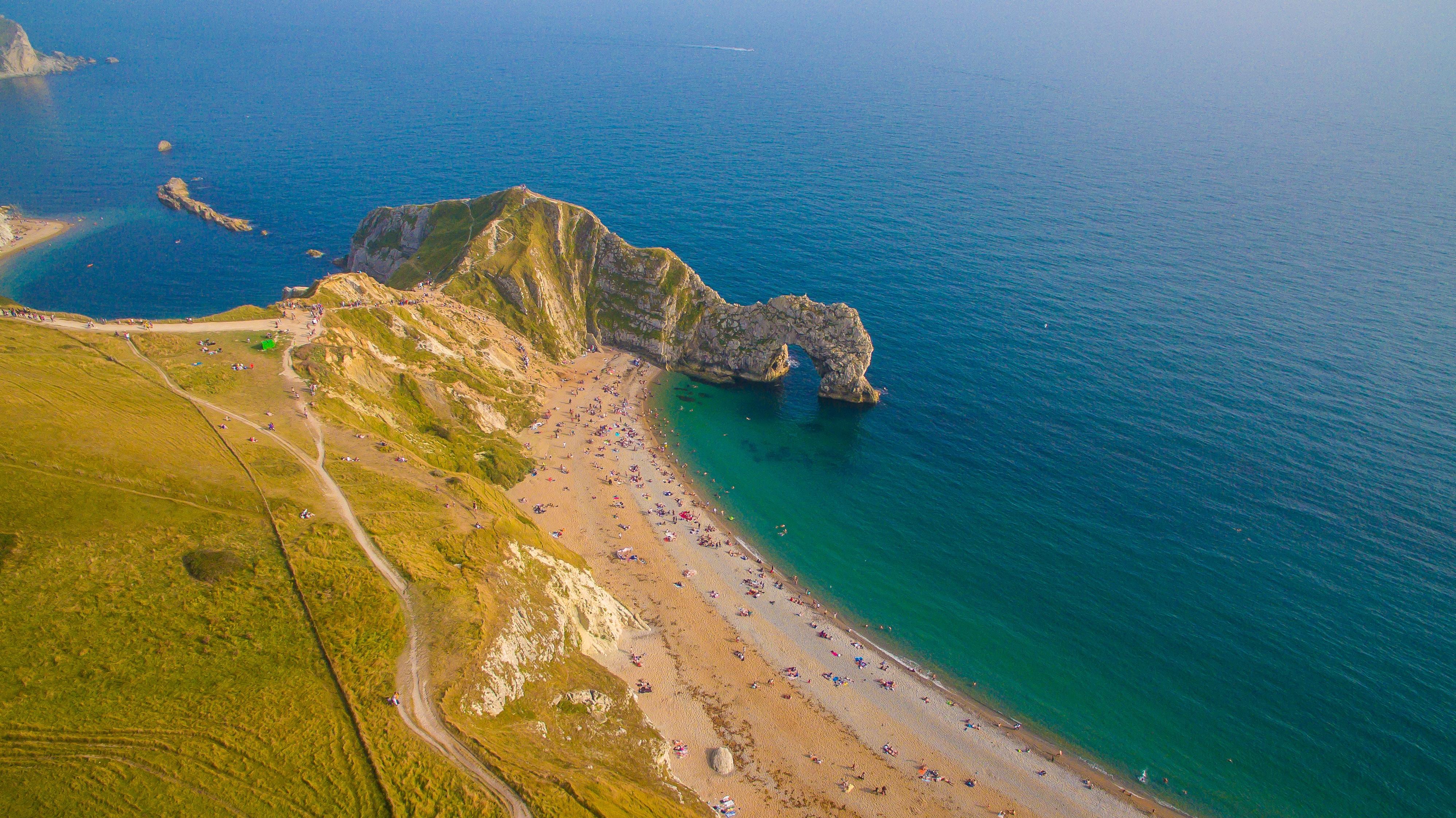 aerial photography of mountain near shore
