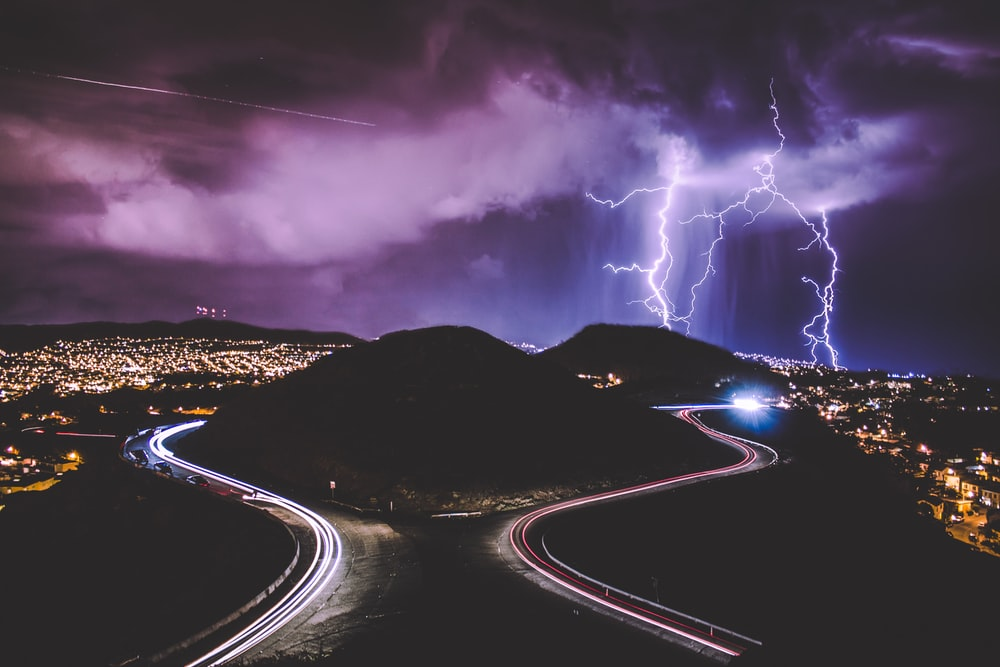 An exuberating look at purple lightning shooting down from a cloud into the city of Twin Peaks