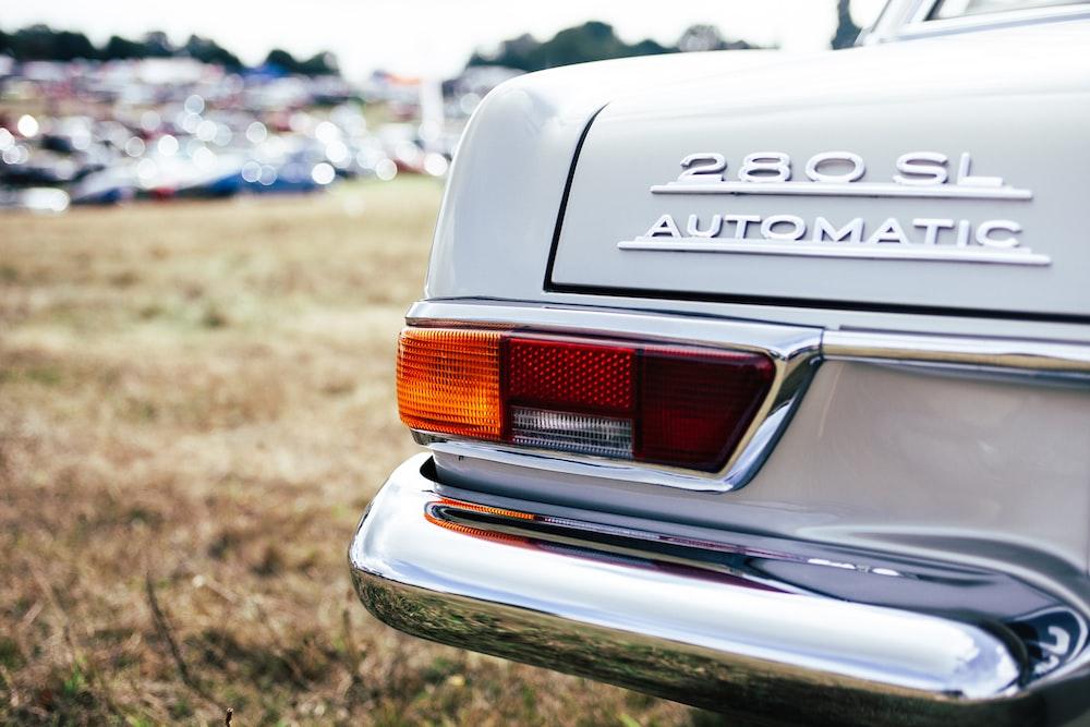 tilt shift lens photo of 280 SL automatic car