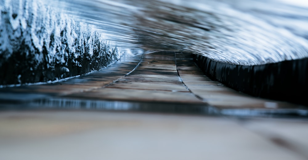 A close up shot of water flowing along a path in the shape of a tunnel