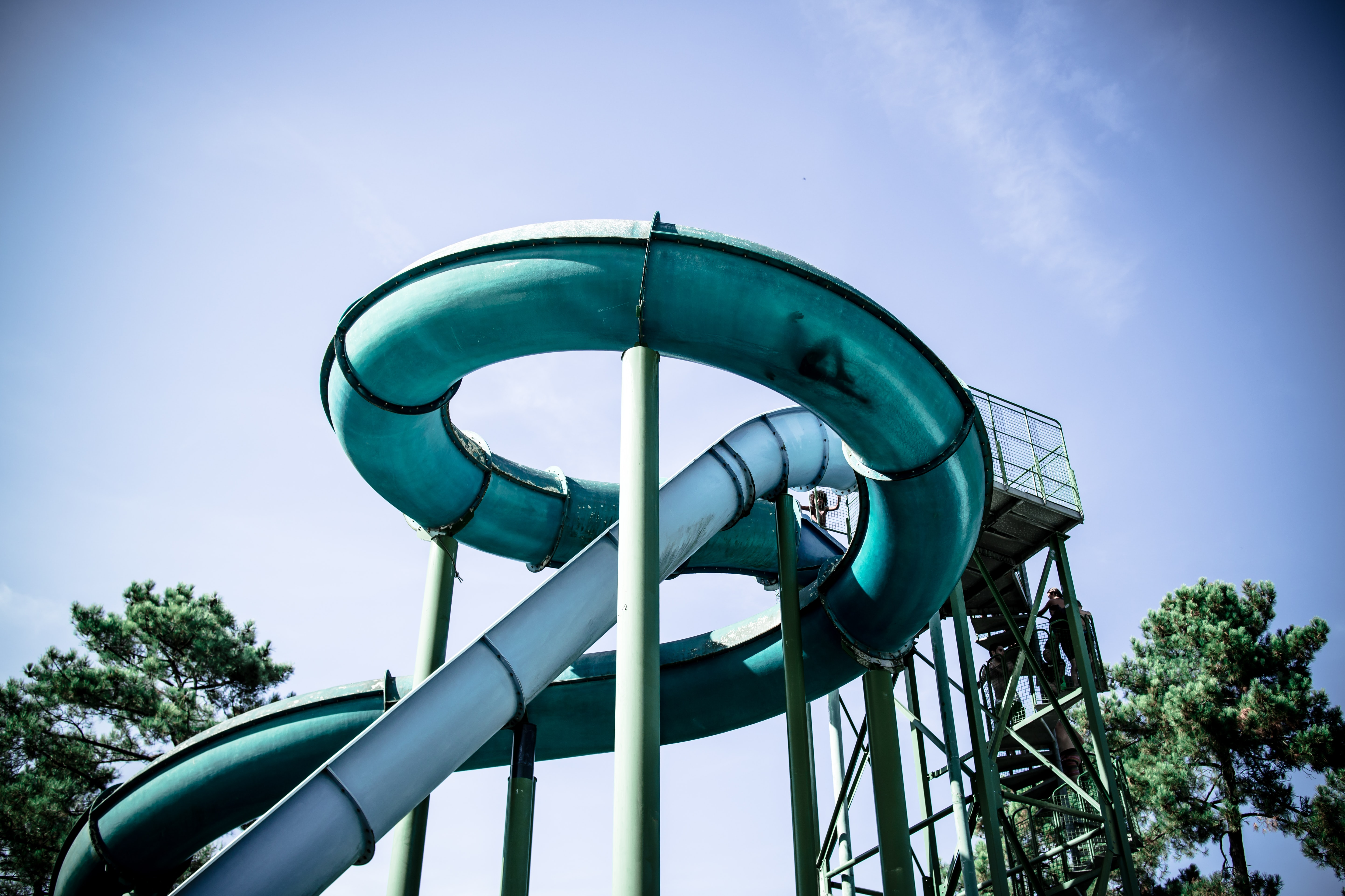 Looking up at a blue and teal tube water slide in Labenne