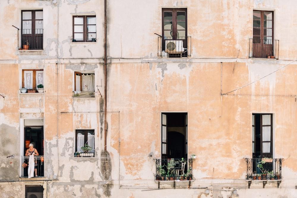 minimalist photography of open windows and doors of building terraces