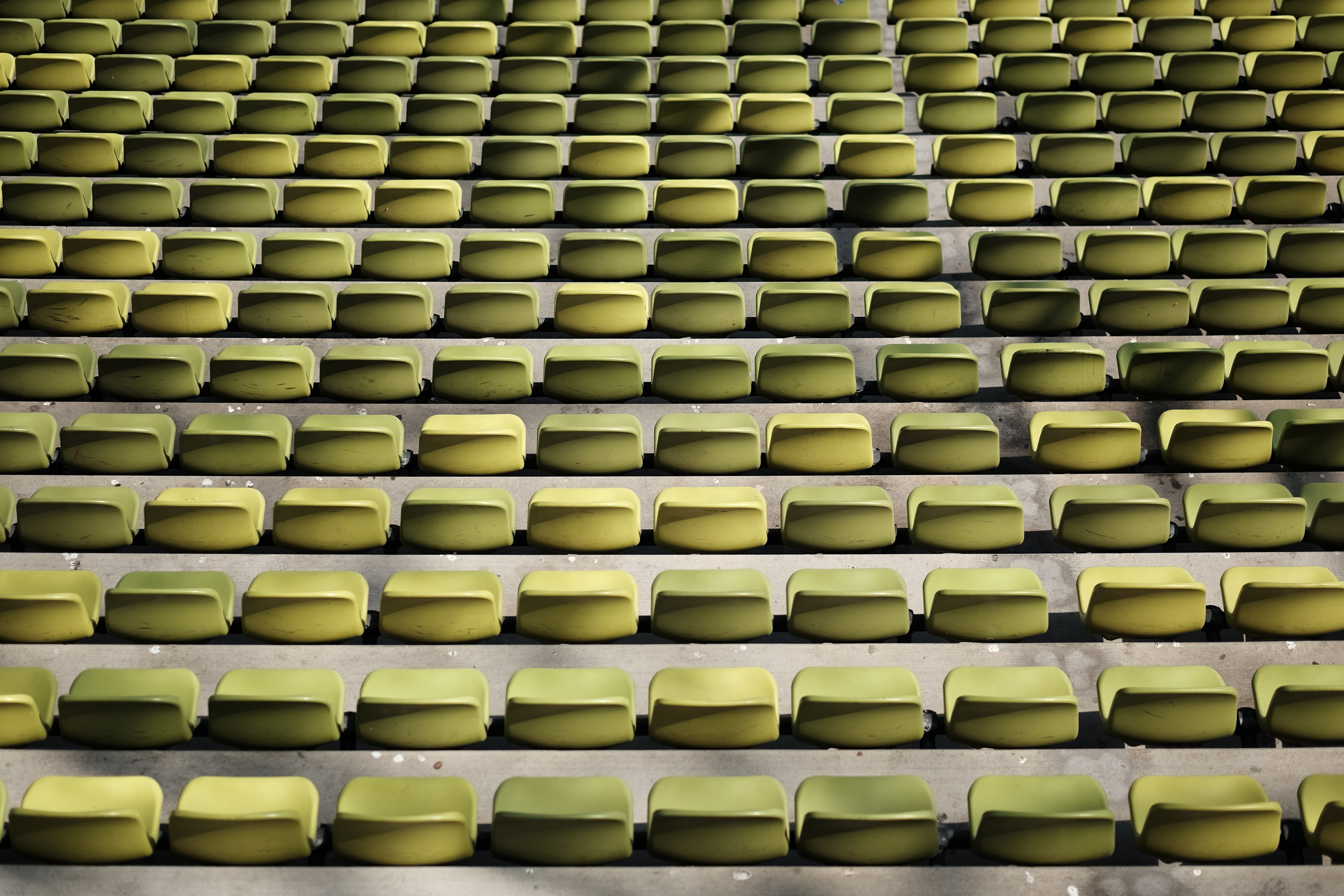 Looking down at a stadium of pastel yellow chairs at Olympia Park