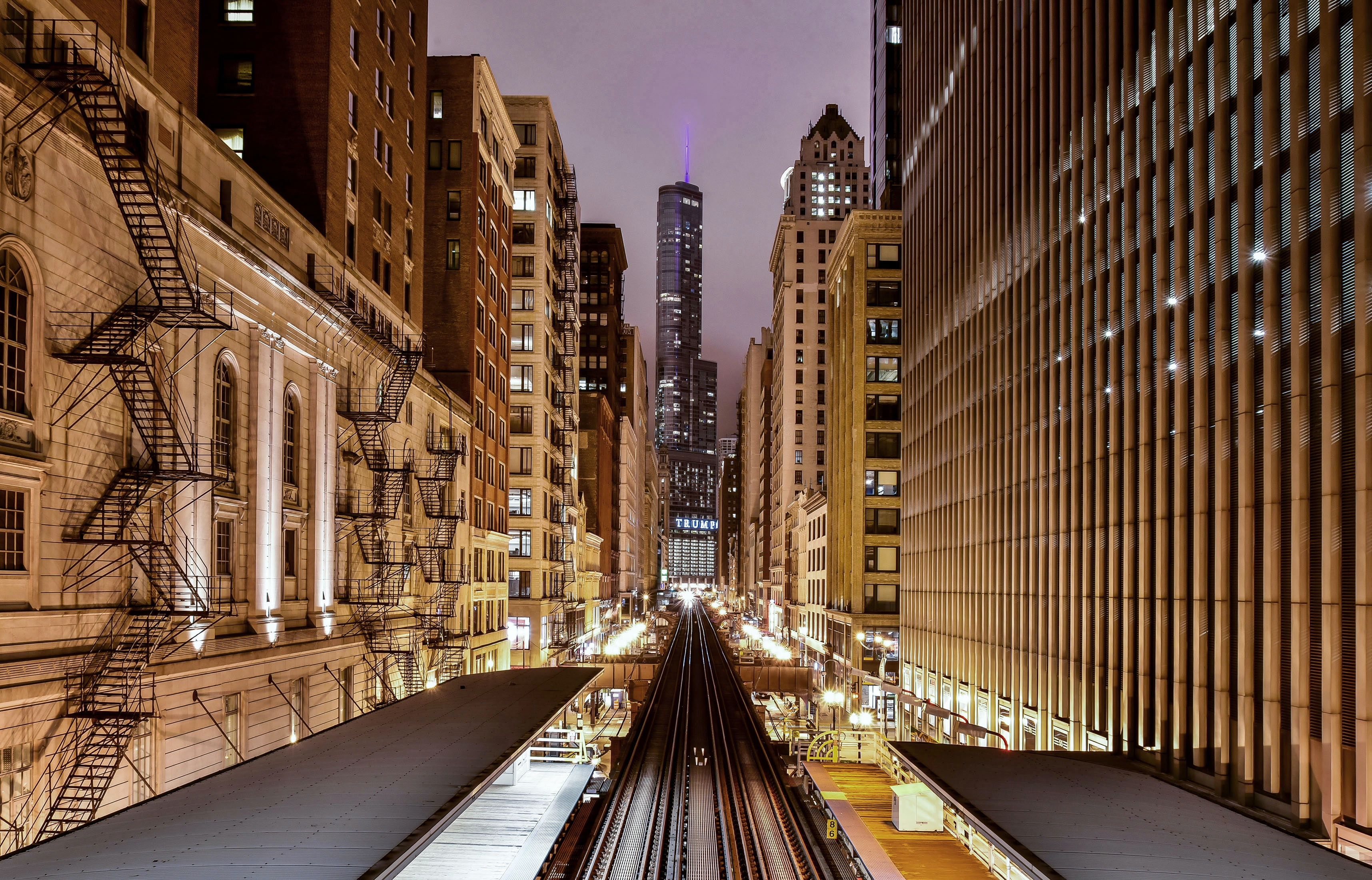 The Adams/Wabash railway station between high-rises in Chicago at night