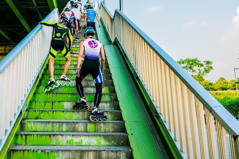 people wearing inline skates going upstairs