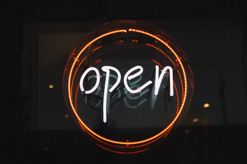 "A round ""open"" neon in white and red"