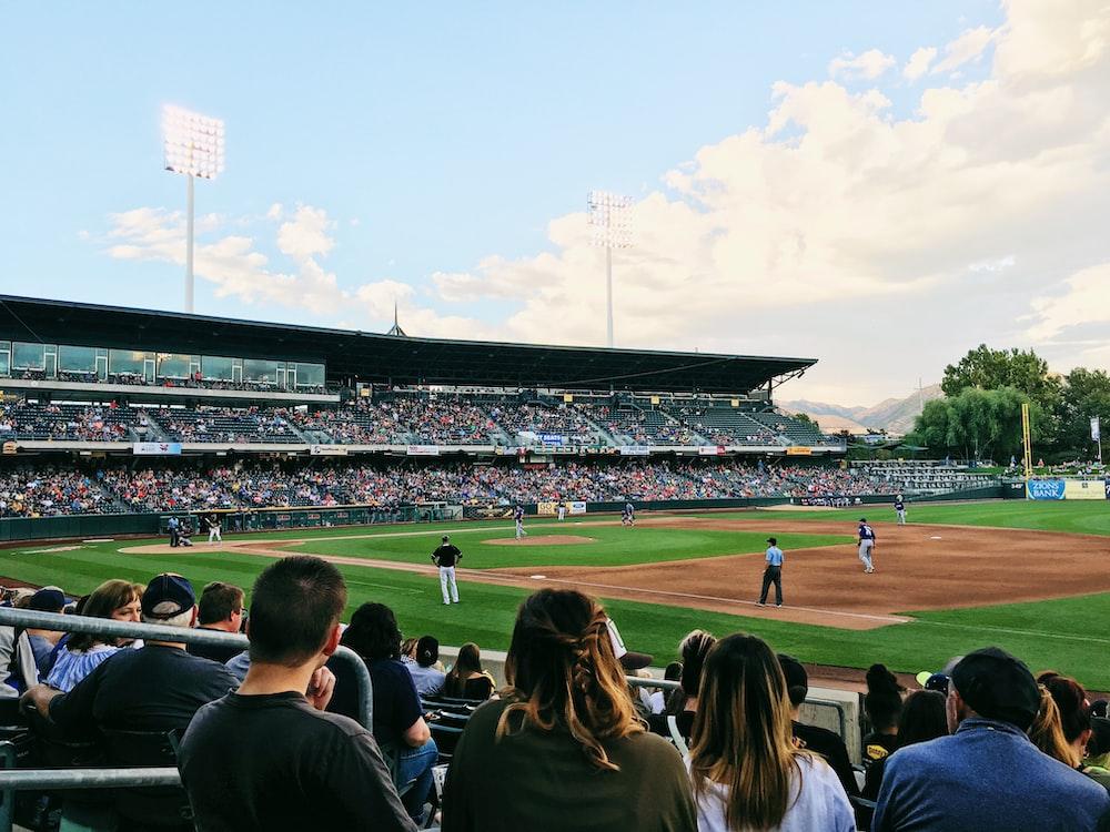 people playing baseball during daytime