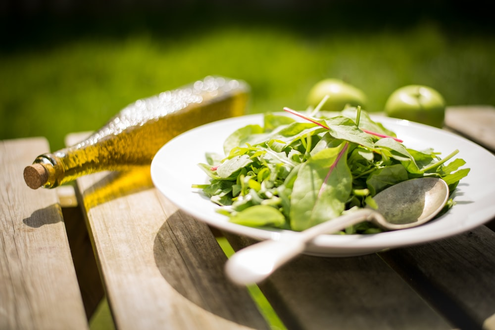 green salad on white plate