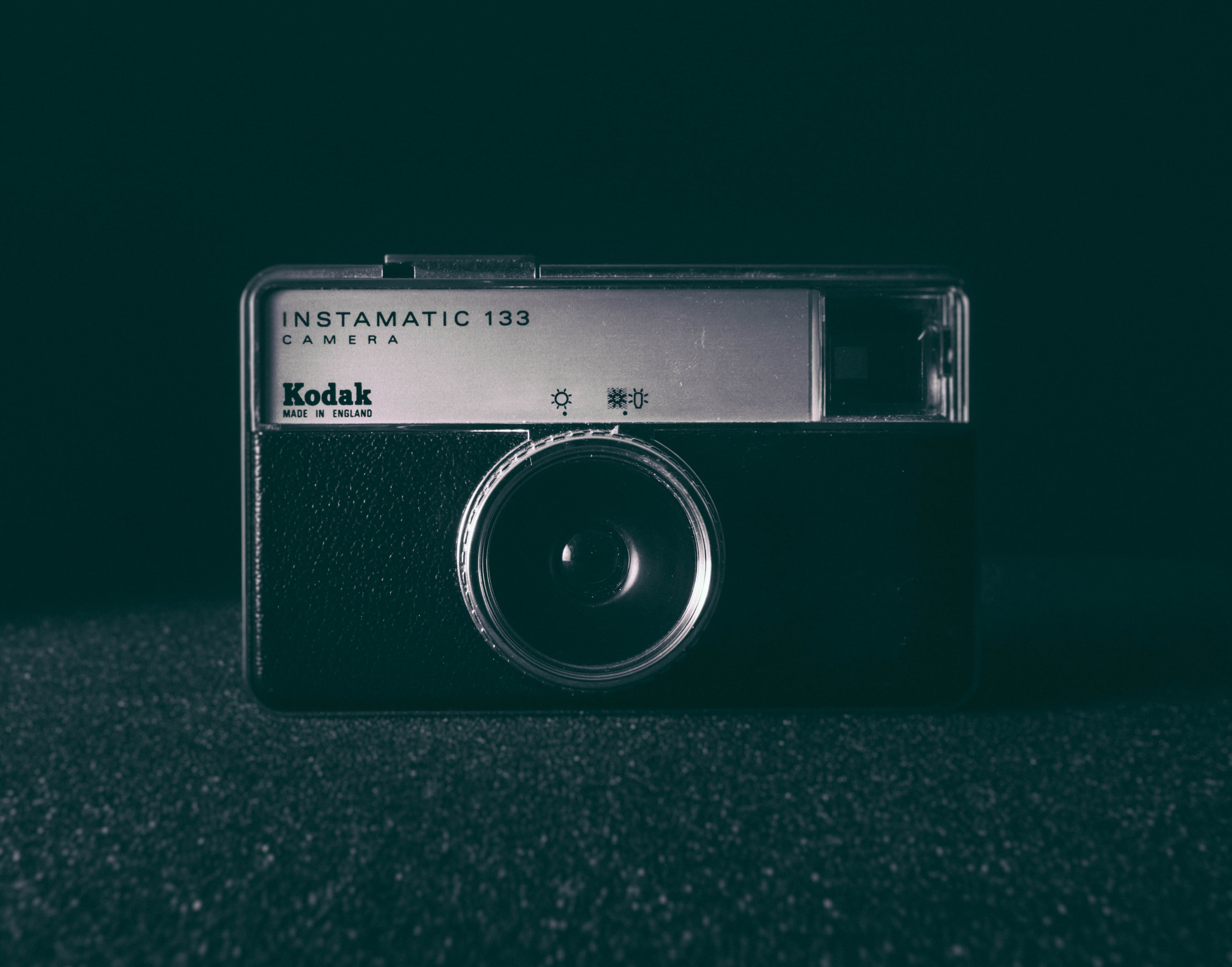 black and white camera on black surface