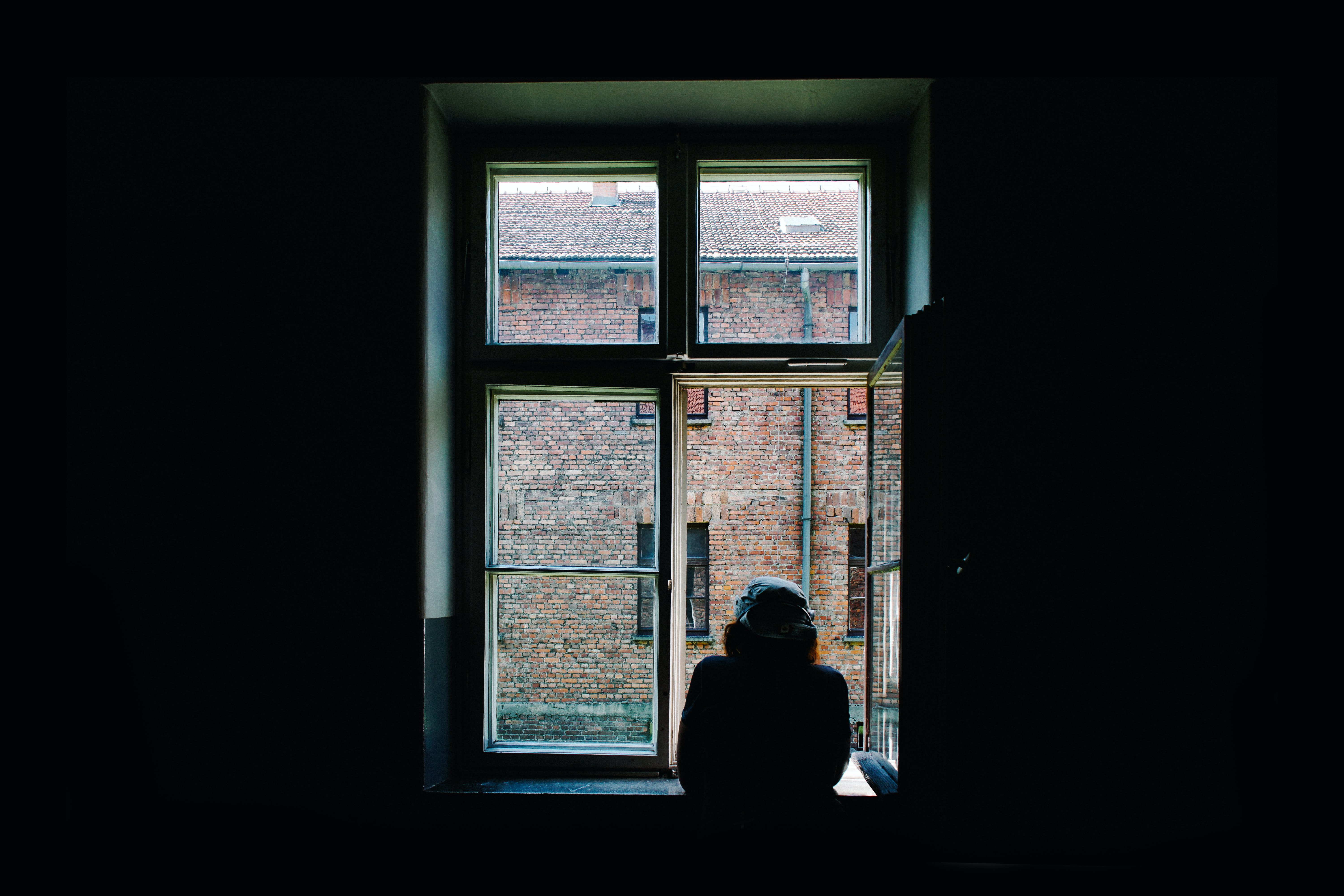 person standing in front of open window