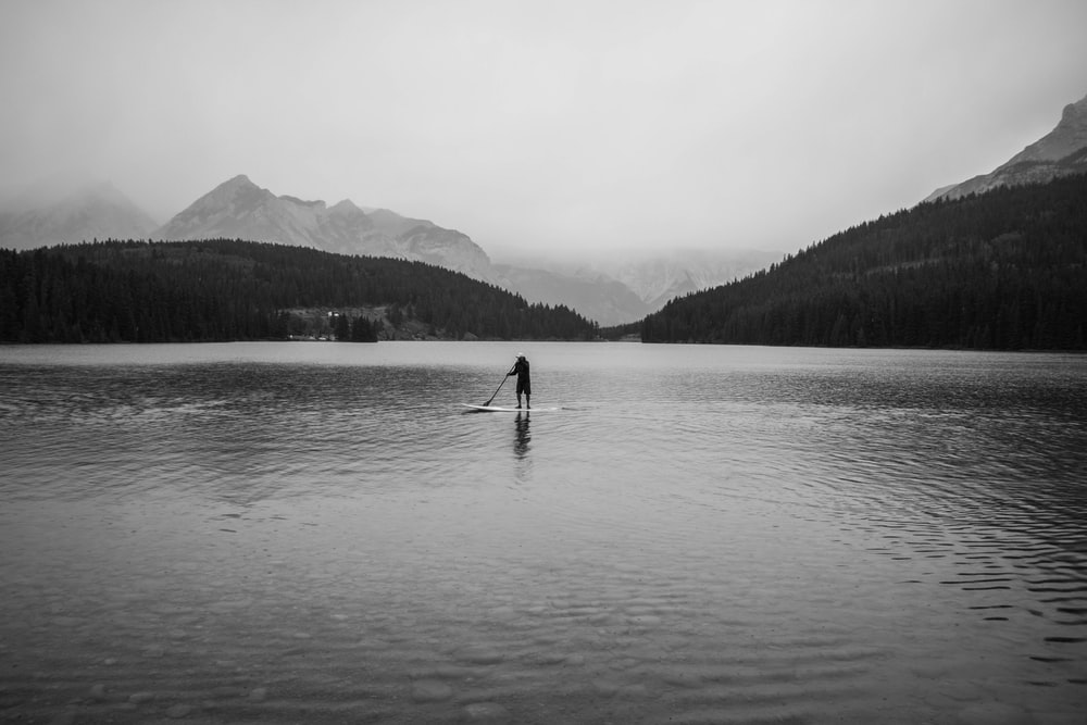 silhouette of person on body of water