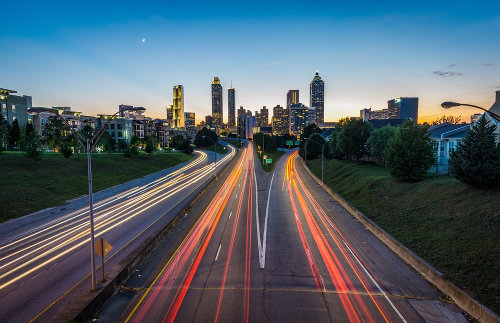 timelapse photo of highway during golden hour