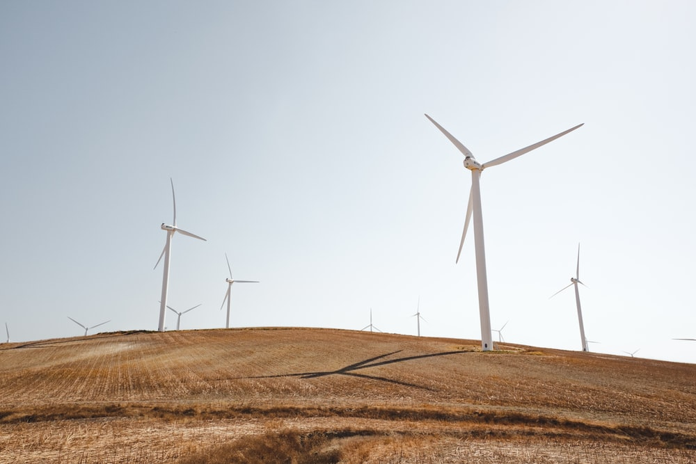 white electric windmills during daytime