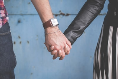 man and woman holding hands holding hand zoom background