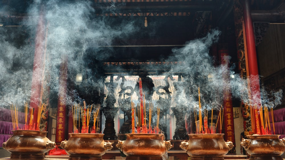 incense on brown vases