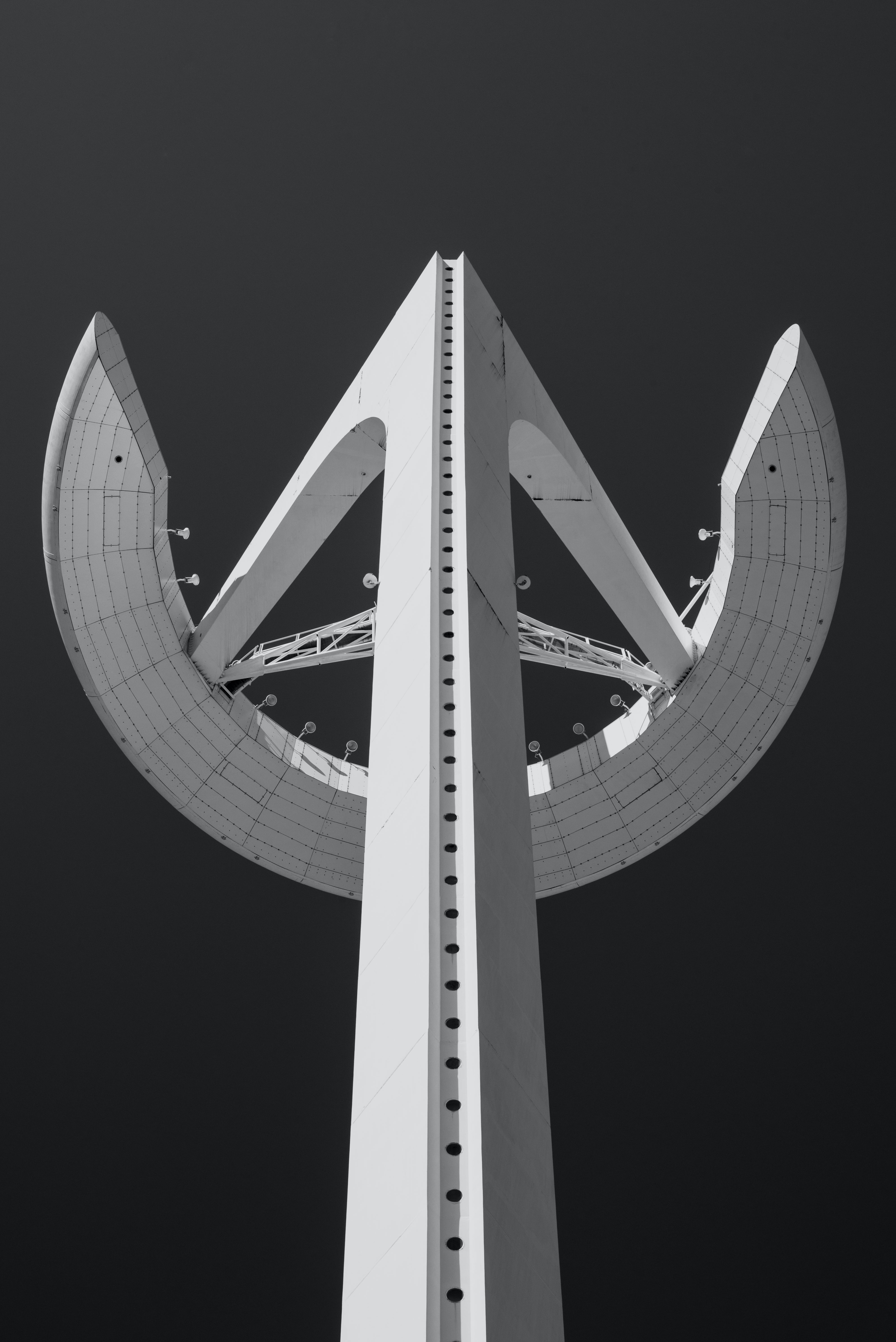 Black and white shot of Montjuïc communications tower from below in Barcelona