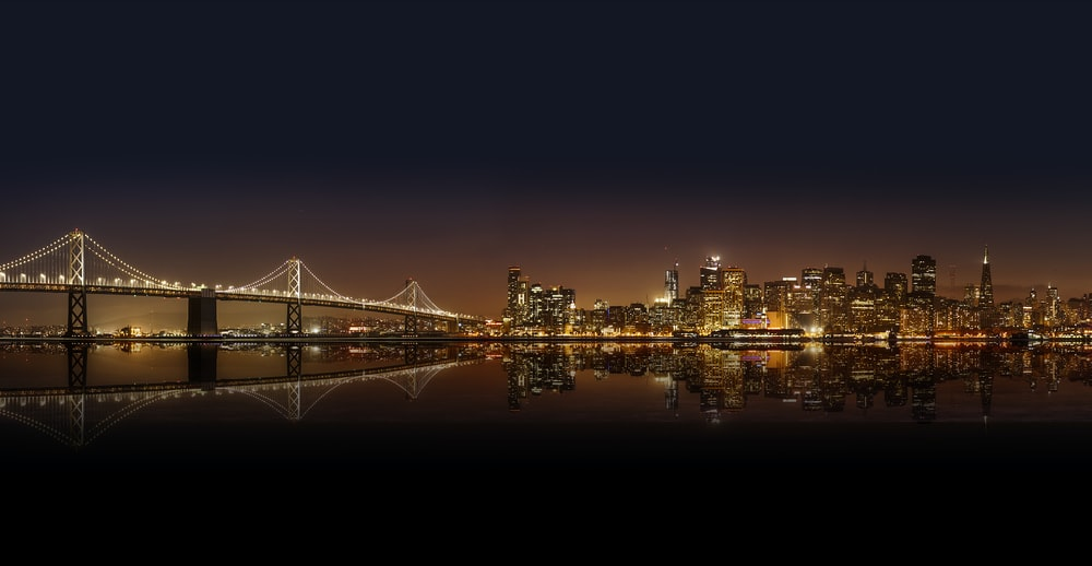 cityscape photography of lighted city with bridge