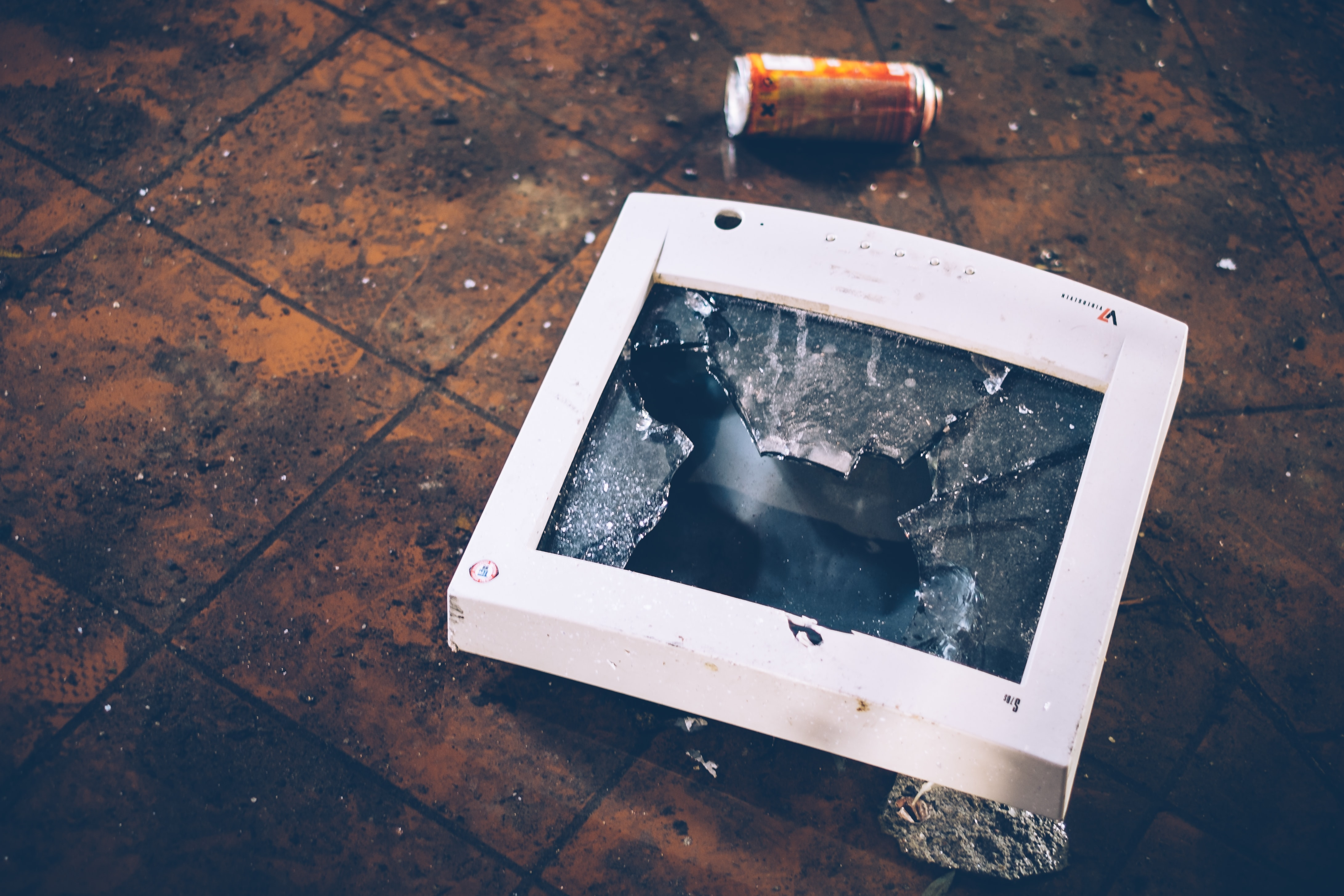 A smashed old piece of display technology on a dirty floor