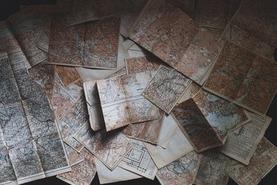 maps lying on the floor vintage teams background