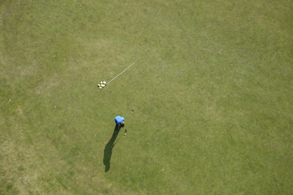 aerial photo of man playing golf
