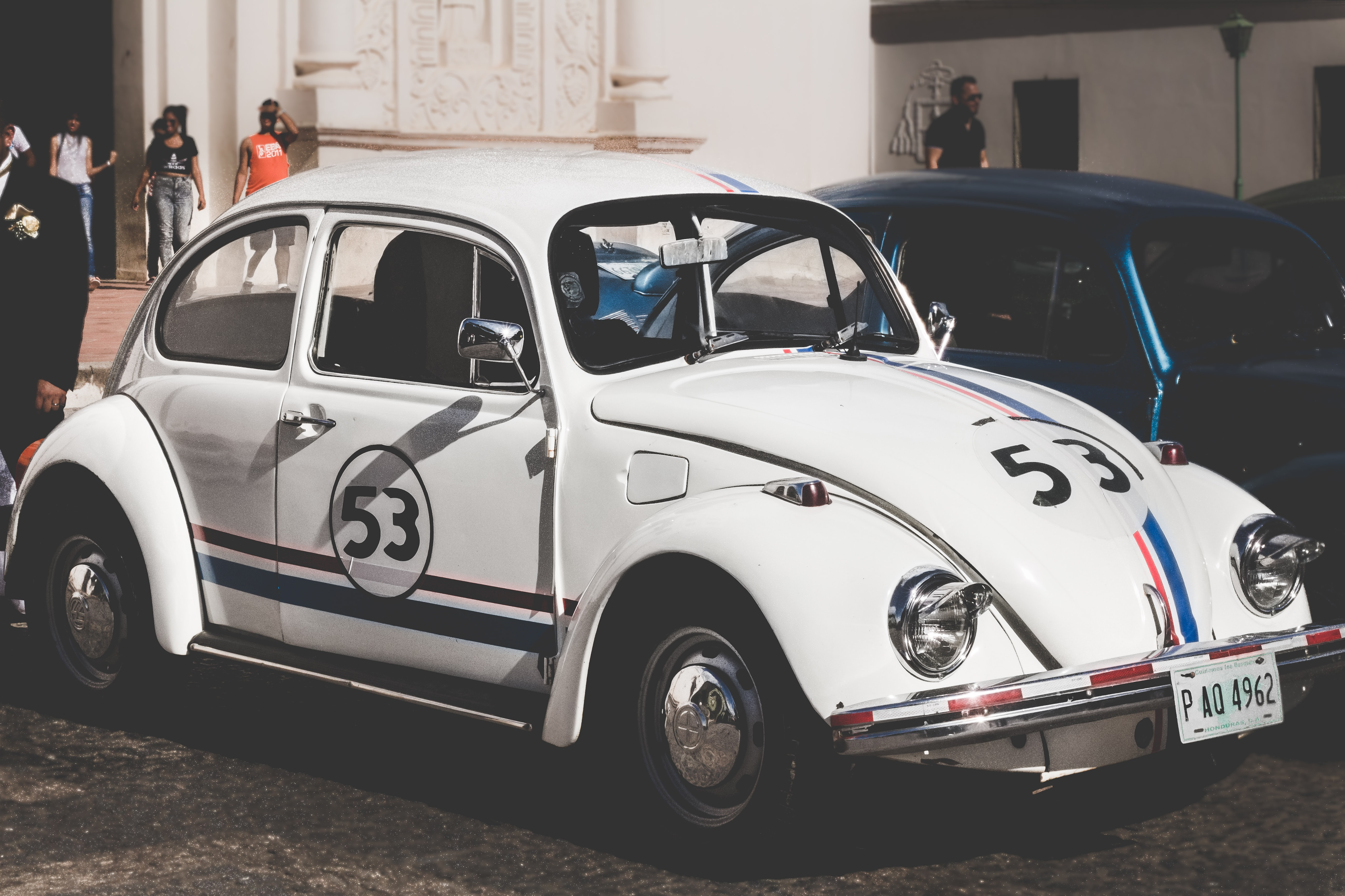 White Volkswagen Herbie Beetle numbered 53 with stripes showcased on the street of Comayagua