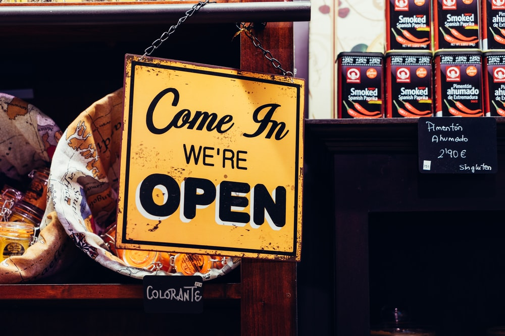 yellow and black come in we're open sign