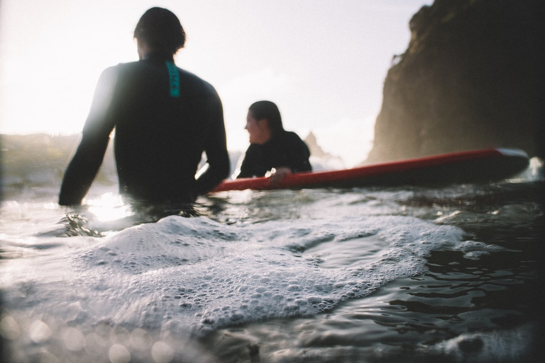 Relaxing surfers at Piha Beach