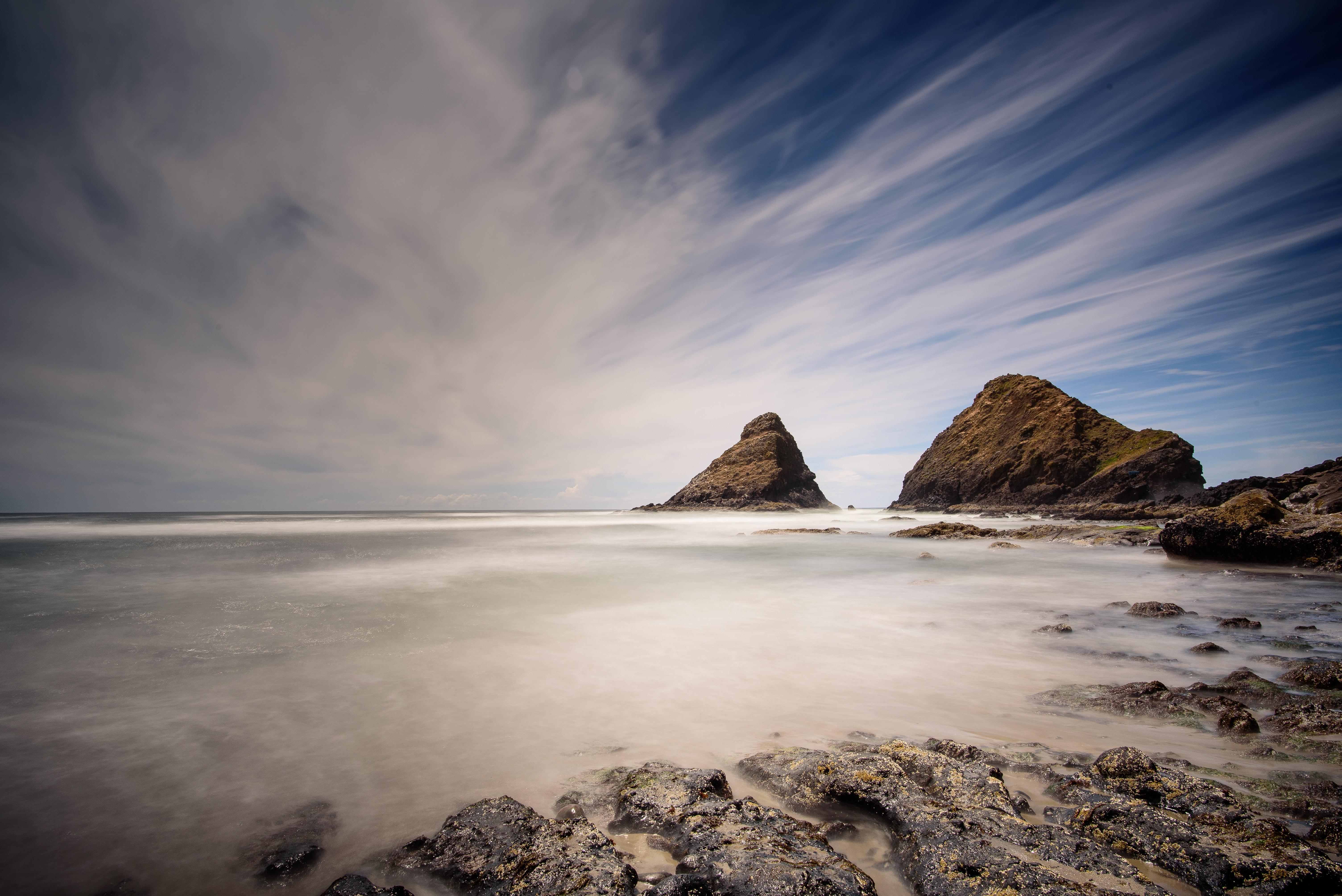Long exposure photo of the rocky ocean shoreline at Heceta Beach