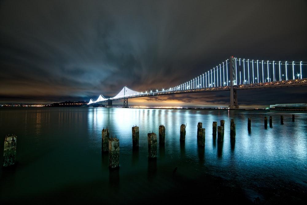 photo of suspension bridge during nighttime
