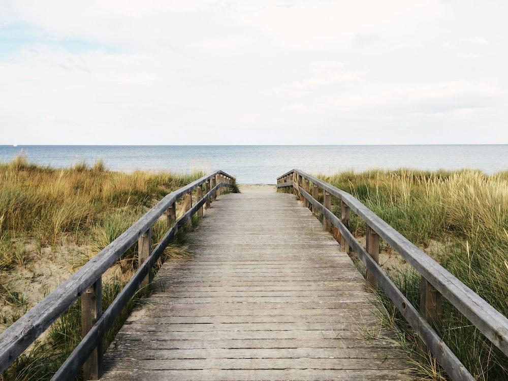 photo of gray wooden bridge