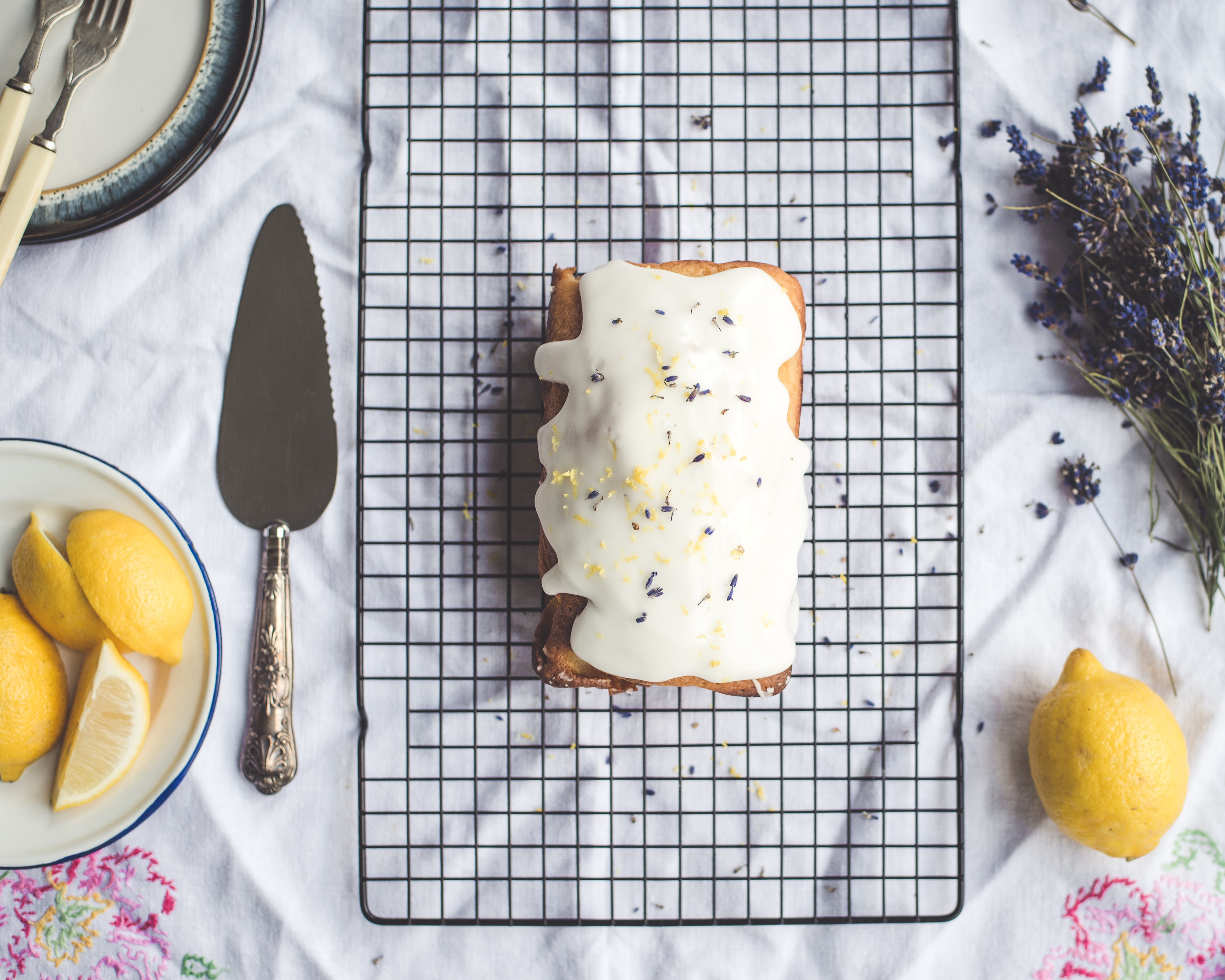 Freshly baked lemon cake with icing and lavender flowers