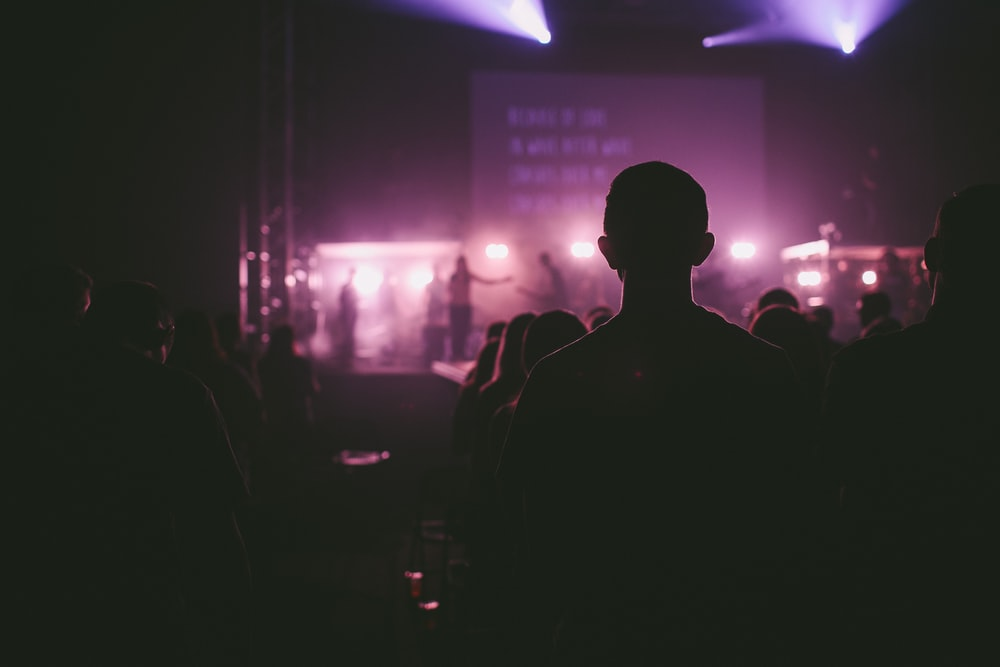 photo of man facing on stage