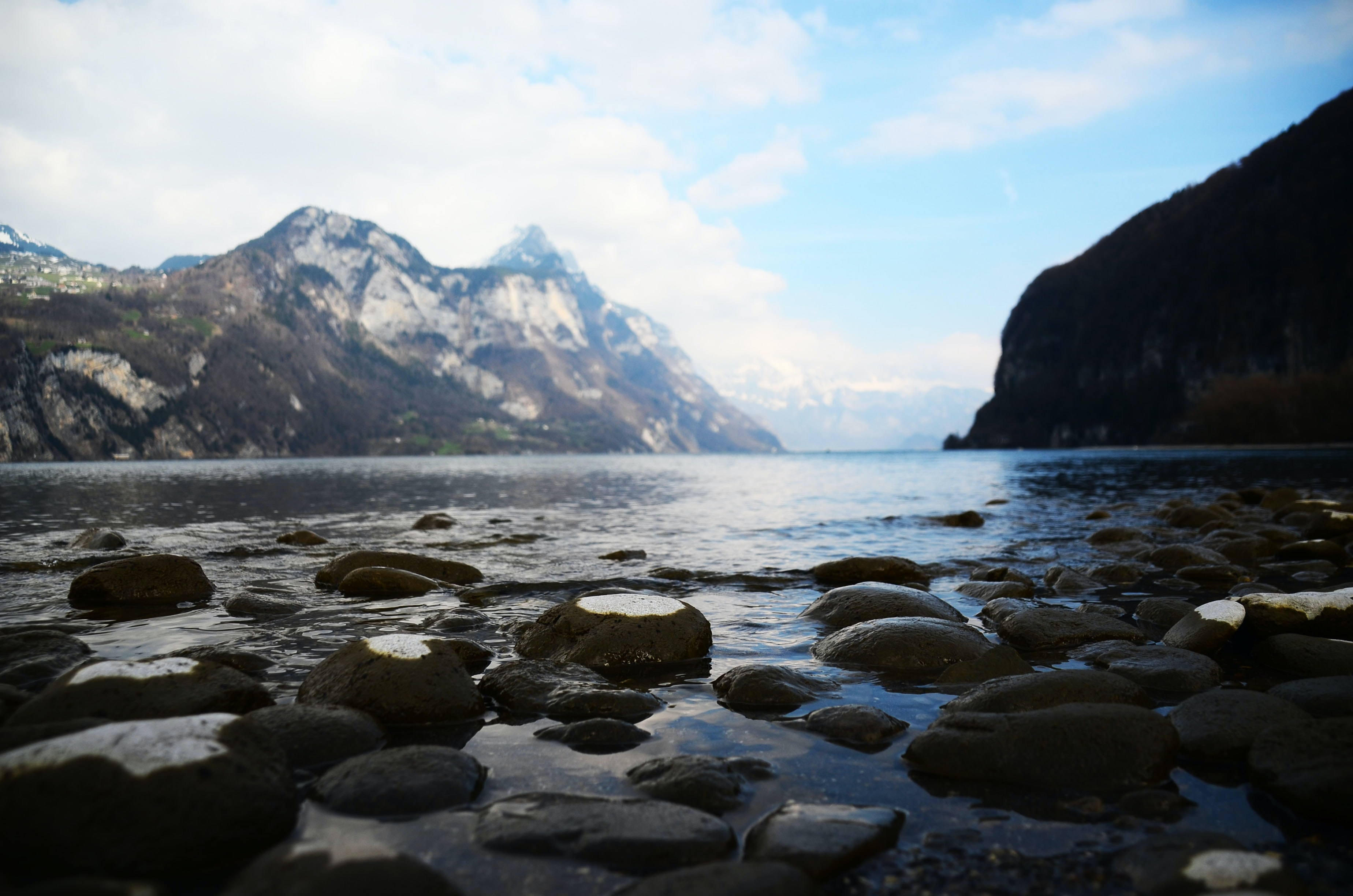 Glossy rocks in a serene mountain lake
