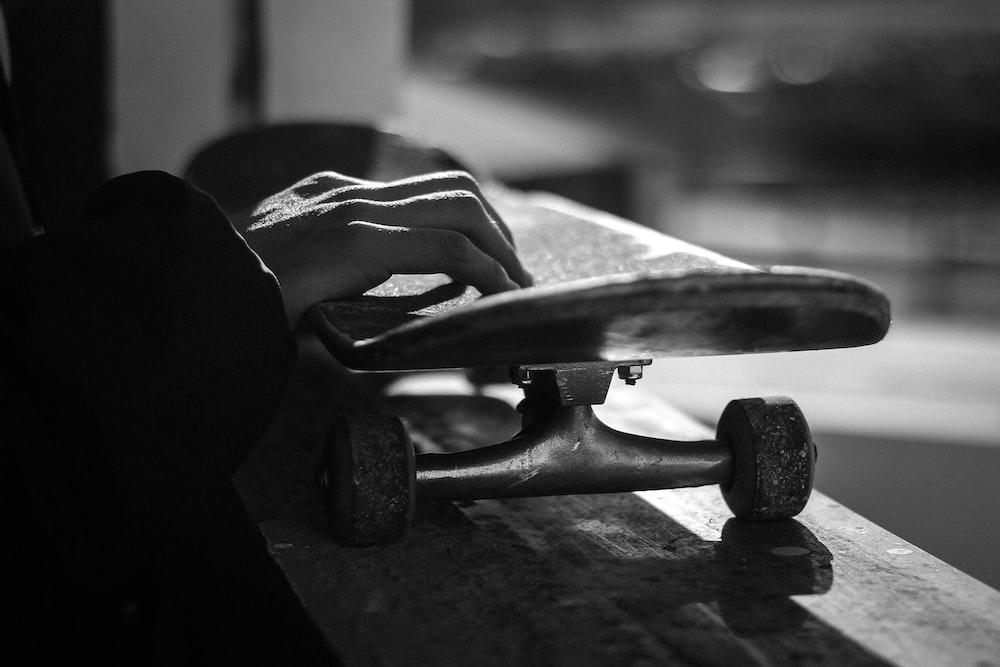greyscale photography of skateboard