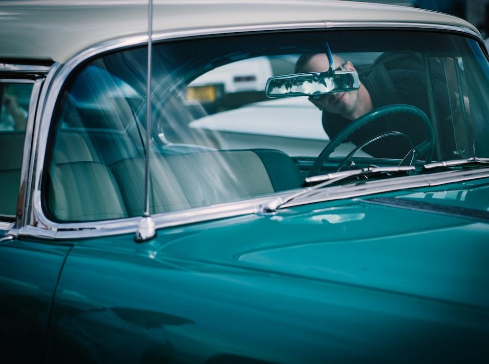 person looking at vehicle interior