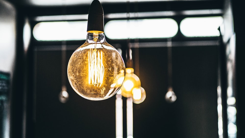 tilt shift lens photography of clear glass bulb