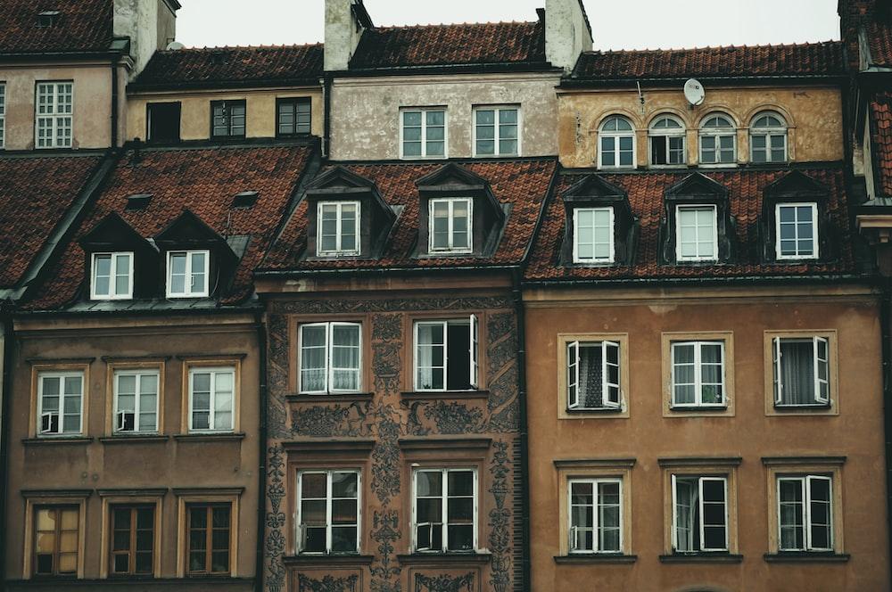 brown concrete buildings under gray sky